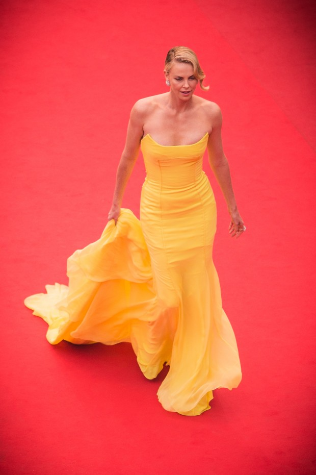 """CANNES, FRANCE – MAY 14:  (EDITORS NOTE : This image was processed using digital filters.) Charlize Theron attends the Premiere of """"Mad Max: Fury Road"""" during the 68th annual Cannes Film Festival on May 14, 2015 in Cannes, France.  (Photo by Francois Durand/Getty Images,,)"""