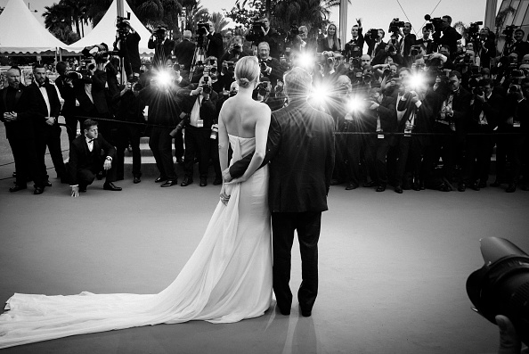 """CANNES, FRANCE – MAY 14:  (EDITORS NOTE: Image has been converted to black and white.) An alternative view of Actors Sean Penn and Charlize Theron attending the premiere of """"Mad Max: Fury Road"""" during the 68th annual Cannes Film Festival on May 14, 2015 in Cannes, France.  (Photo by Clemens Bilan/French Select)"""