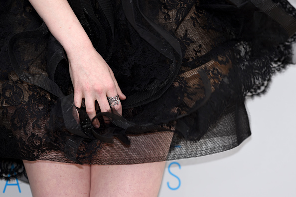 """CANNES, FRANCE – MAY 15:  Actress Emma Stone, jewelry detail, attends a photocall for """"Irrational Man"""" during the 68th annual Cannes Film Festival on May 15, 2015 in Cannes, France.  (Photo by Ben A. Pruchnie/Getty Images)"""