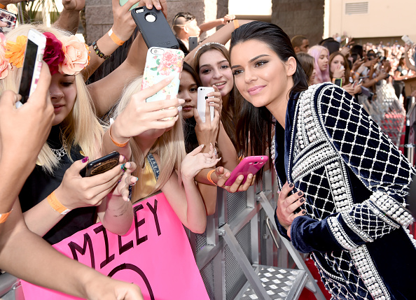 LAS VEGAS, NV – MAY 17:  Model Kendall Jenner, wearing wearing Balmain x H&M, poses for selfies with fans during the 2015 Billboard Music Awards at MGM Grand Garden Arena on May 17, 2015 in Las Vegas, Nevada.  (Photo by Jeff Kravitz/BMA2015/FilmMagic)