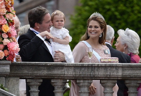 (L to R) Christopher ONeill, Princess Leonore and Sweden's Princess Madeleine stand outside the Stockholm Palace after the wedding ceremony of Sweden's Crown Prince Carl Philip and Sofia Hellqvist on June 13, 2015. AFP PHOTO / JONATHAN NACKSTRAND        (Photo credit should read JONATHAN NACKSTRAND/AFP/Getty Images)