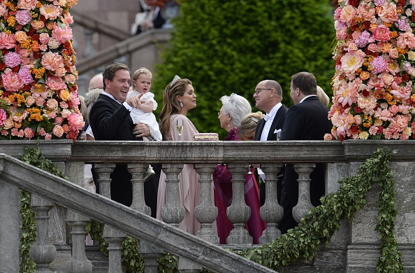 (L to R) Christopher ONeill, Princess Leonore and Sweden's Princess Madeleine stand outside the Stockholm Palace with guests after the wedding ceremony of Sweden's Crown Prince Carl Philip and Sofia Hellqvist on June 13, 2015. AFP PHOTO / JONATHAN NACKSTRAND        (Photo credit should read JONATHAN NACKSTRAND/AFP/Getty Images)
