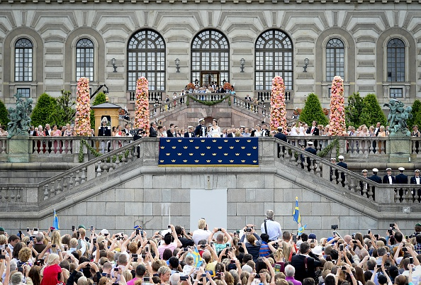 A general overview shows Sweden's Princess Sofia and Sweden's Prince Carl Philip greeting the crowd after their wedding ceremony at Stockholm Palace on June 13, 2015.  AFP PHOTO / JONATHAN NACKSTRAND        (Photo credit should read JONATHAN NACKSTRAND/AFP/Getty Images)