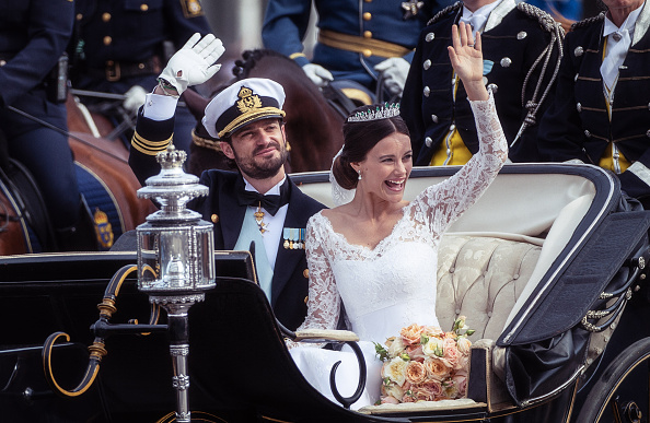 STOCKHOLM, SWEDEN – JUNE 13: Prince Carl Philip of Sweden and his wife Princess Sofia of Sweden ride in the wedding cortege after their marriage ceremony on June 13, 2015 in Stockholm, Sweden.  (Photo by Ian Gavan/Getty Images)