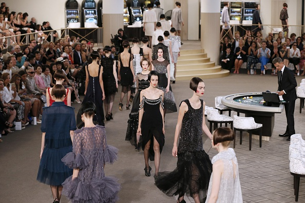 Models present creations for Chanel during the 2015-2016 fall/winter Haute Couture collection fashion show on July 7, 2015 at the Grand Palais in Paris.            AFP PHOTO / PATRICK KOVARIK        (Photo credit should read PATRICK KOVARIK/AFP/Getty Images)