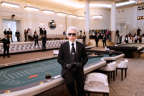 PARIS, FRANCE – JULY 07:  (EDITORS NOTE: This image has been retouched) Fashion Designer Karl Lagerfeld attends the Chanel show as part of Paris Fashion Week Haute Couture Fall/Winter 2015/2016. Held at Grand Palais on July 7, 2015 in Paris, France.  (Photo by Bertrand Rindoff Petroff/Getty Images)