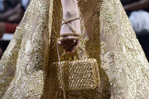 PARIS, FRANCE – JULY 08:  A model, bag detail, walks the runway during the Elie Saab show as part of Paris Fashion Week Haute Couture Fall/Winter 2015/2016 on July 8, 2015 in Paris, France.  (Photo by Dominique Charriau/WireImage)