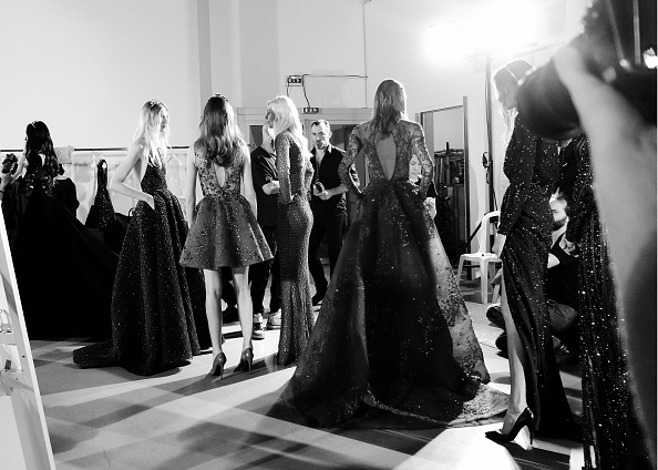 PARIS, FRANCE – JULY 09:  (EDITORS NOTE: Image has been converted to black and white) Models line up backstage before the Zuhair Murad show as part of Paris Fashion Week Haute Couture Fall/Winter 2015/2016 at Palais de Tokyo on July 9, 2015 in Paris, France.  (Photo by Gareth Cattermole/Getty Images)