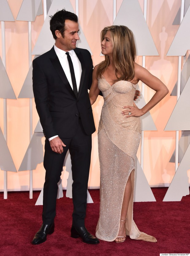Justin Theroux, left, and Jennifer Aniston arrive at the Oscars on Sunday, Feb. 22, 2015, at the Dolby Theatre in Los Angeles. (Photo by Jordan Strauss/Invision/AP)