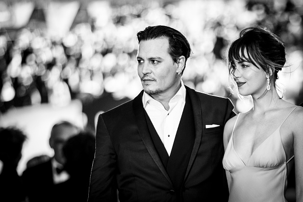 VENICE, ITALY – SEPTEMBER 04:  (EDITOR NOTE: Image has been converted to black & white)  An alternative view of Johnny Depp and Dakota Johnson  as they attend a premiere for 'Black Mass' during the 72nd Venice Film Festival at  on September 4, 2015 in Venice, Italy.  (Photo by Tristan Fewings/Getty Images)
