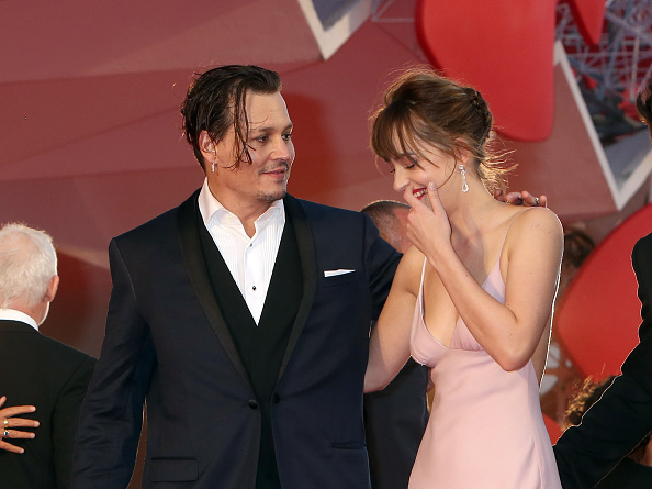 VENICE, ITALY – SEPTEMBER 04:  Johnny Depp and Dakota Johnson attend a premiere for 'Black Mass' during the 72nd Venice Film Festival on September 4, 2015 in Venice, Italy.  (Photo by Elisabetta A. Villa/WireImage)