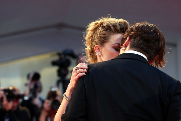 VENICE, ITALY – SEPTEMBER 05:  Johnny Depp kisses Amber Heard during a premiere for 'A Danish Girl' during the 72nd Venice Film Festival at  on September 5, 2015 in Venice, Italy.  (Photo by Franco Origlia/Getty Images)