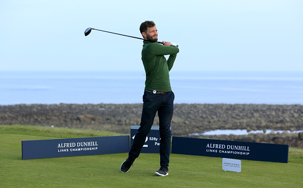 KINGSBARNS, SCOTLAND – OCTOBER 03:  Jamie Dornan the film actor plays his tee shot on the 12th hole during the third round of the 2015 Alfred Dunhill Links Championship at Kingsbarns on October 3, 2015 in Kingsbarns, Scotland.  (Photo by David Cannon/Getty Images)