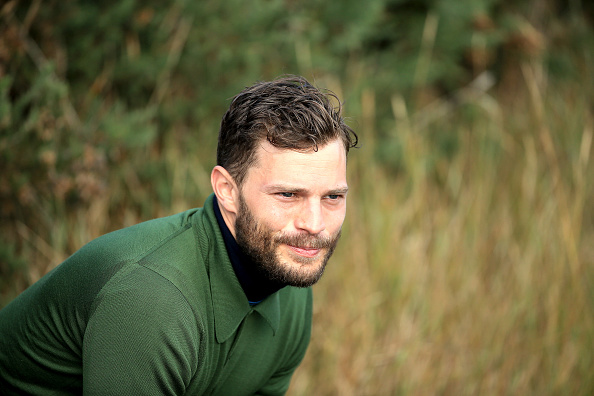 KINGSBARNS, SCOTLAND – OCTOBER 03:  Jamie Dornan the film actor waiting on the 12th tee during the third round of the 2015 Alfred Dunhill Links Championship at Kingsbarns on October 3, 2015 in Kingsbarns, Scotland.  (Photo by David Cannon/Getty Images)