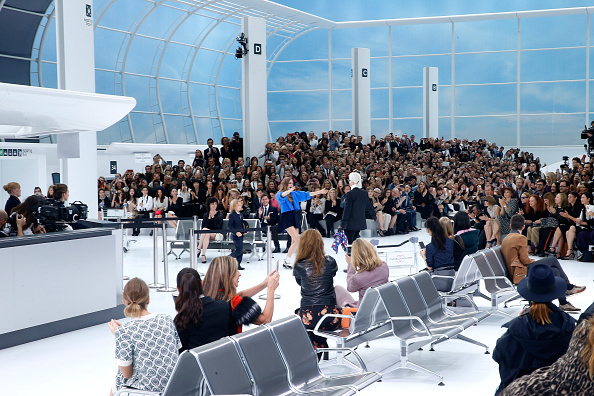 PARIS, FRANCE – OCTOBER 06:  Fashion Designer Karl Lagerfeld, Hudson Kroenig and Model Cara Delevingne acknowledge the applause of the audience at the end of the Chanel show as part of the Paris Fashion Week Womenswear Spring/Summer 2016 on October 6, 2015 in Paris, France.  (Photo by Rindoff/Le Segretain/Getty Images)