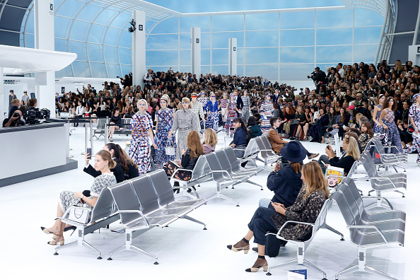 """PARIS, FRANCE – OCTOBER 06:  Illustration view of Models in the """"Chanel Airport"""" during the Chanel show as part of the Paris Fashion Week Womenswear Spring/Summer 2016 on October 6, 2015 in Paris, France.  (Photo by Rindoff/Le Segretain/Getty Images)"""