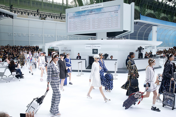 """PARIS, FRANCE - OCTOBER 06:  Illustration view of Models in the """"Chanel Airport"""" during the Chanel show as part of the Paris Fashion Week Womenswear Spring/Summer 2016 on October 6, 2015 in Paris, France.  (Photo by Rindoff/Le Segretain/Getty Images)"""