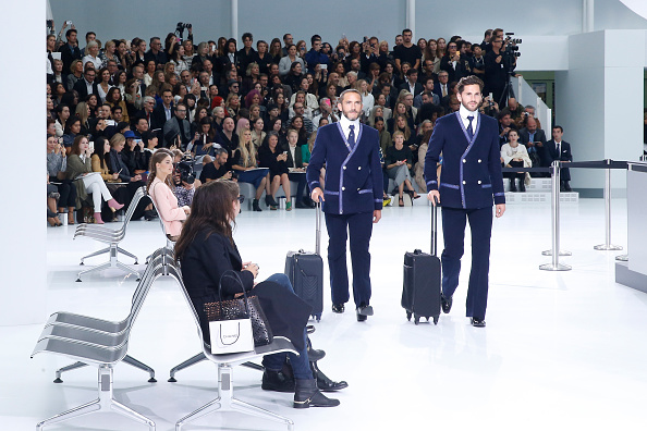"""PARIS, FRANCE – OCTOBER 06:  Illustration view of Sebastien Jondeau and Models in the """"Chanel Airport"""" during the Chanel show as part of the Paris Fashion Week Womenswear Spring/Summer 2016 on October 6, 2015 in Paris, France.  (Photo by Rindoff/Le Segretain/Getty Images)"""