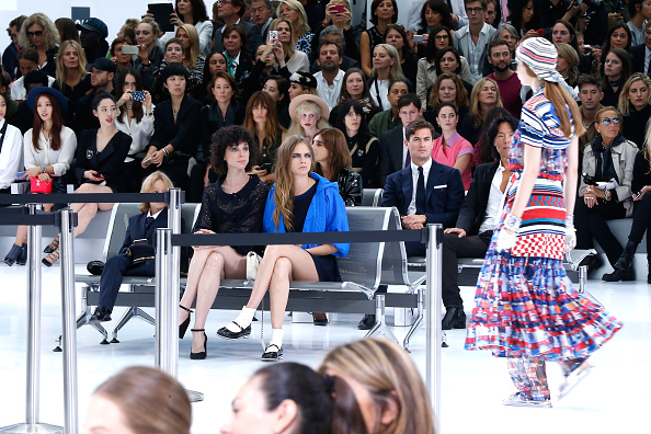 PARIS, FRANCE – OCTOBER 06:  Annie Clark alias 'St. Vincent' and Model Cara Delevingne attend the Chanel show as part of the Paris Fashion Week Womenswear Spring/Summer 2016 on October 6, 2015 in Paris, France.  (Photo by Rindoff/Le Segretain/Getty Images)