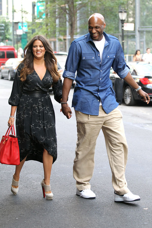 Khloe Kardashian and husband Lamar Odom visit his kids school in Battery Park.