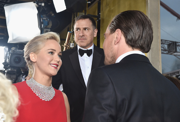 BEVERLY HILLS, CA – JANUARY 10:  73rd ANNUAL GOLDEN GLOBE AWARDS — Pictured: (l-r) Actress Jennifer Lawrence, director David O. Russell and actor Leonardo DiCaprio arrive to the 73rd Annual Golden Globe Awards held at the Beverly Hilton Hotel on January 10, 2016.  (Photo by Alberto Rodriguez/NBC/NBCU Photo Bank via Getty Images)