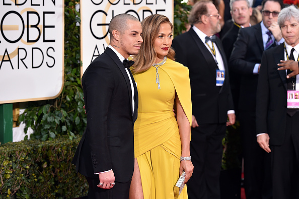 BEVERLY HILLS, CA – JANUARY 10: Dancer Casper Smart (L) and actress Jennifer Lopez attend the 73rd Annual Golden Globe Awards held at the Beverly Hilton Hotel on January 10, 2016 in Beverly Hills, California.  (Photo by John Shearer/Getty Images)
