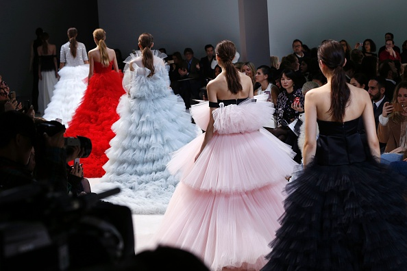 Models present creations for Giambattista Valli during the 2016 spring/summer Haute Couture collection on January 25, 2016 in Paris.   AFP PHOTO / FRANCOIS GUILLOT / AFP / FRANCOIS GUILLOT        (Photo credit should read FRANCOIS GUILLOT/AFP/Getty Images)