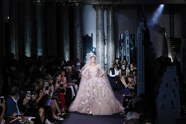 A model presents a creation by Elie Saab during the 2016-2017 fall/winter Haute Couture collection fashion show on July 6, 2016 in Paris. / AFP / FRANCOIS GUILLOT        (Photo credit should read FRANCOIS GUILLOT/AFP/Getty Images)