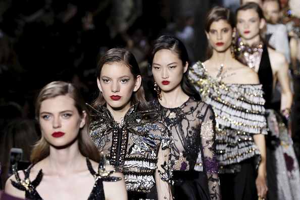Models present creations by Elie Saab during the 2016-2017 fall/winter Haute Couture collection fashion show on July 6, 2016 in Paris. / AFP / FRANCOIS GUILLOT        (Photo credit should read FRANCOIS GUILLOT/AFP/Getty Images)