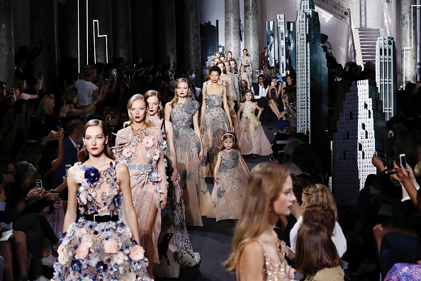 Models present creation by Elie Saab during the 2016-2017 fall/winter Haute Couture collection fashion show on July 6, 2016 in Paris. / AFP / FRANCOIS GUILLOT        (Photo credit should read FRANCOIS GUILLOT/AFP/Getty Images)