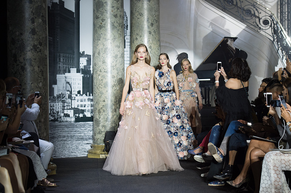PARIS, FRANCE – JULY 06:  Models walk the runway during the Elie Saab  Haute Couture Fall/Winter 2016-2017 show as part of Paris Fashion Week  on July 6, 2016 in Paris, France.  (Photo by Stephane Cardinale – Corbis/Corbis via Getty Images)