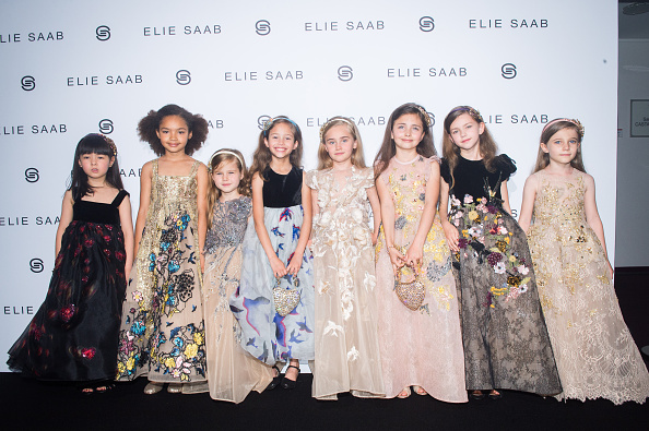 PARIS, FRANCE – JULY 06: Kids models pose after the Elie Saab Haute Couture Fall/Winter 2016-2017 show as part of Paris Fashion Week  on July 6, 2016 in Paris, France.  (Photo by Stephane Cardinale – Corbis/Corbis via Getty Images)