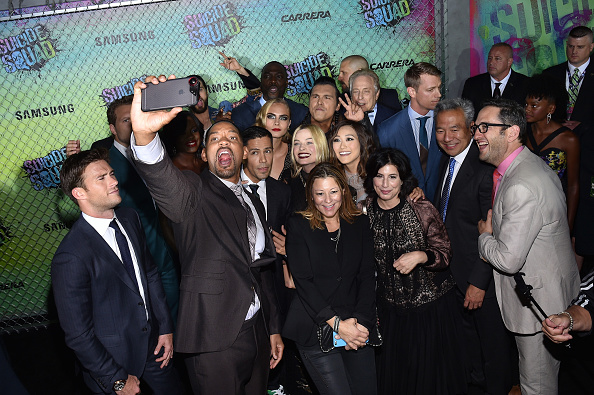 NEW YORK, NY – AUGUST 01:  The cast and crew of Suicide Squade take a selfie during the Suicide Squad premiere sponsored by Carrera at Beacon Theatre on August 1, 2016 in New York City.  (Photo by Bryan Bedder/Getty Images for Carrera)