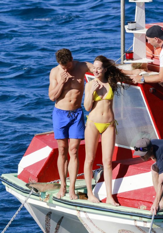 dakota-johnson-in-yellow-bikini-fifty-shades-freed-set-in-france-july-2016-1_thumbnail