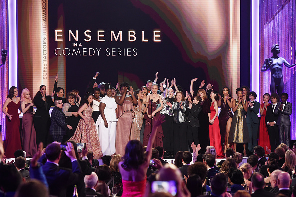 LOS ANGELES, CA – JANUARY 29:  Actor Taylor Schilling (C) and cast of 'Orange Is the New Black' accept Outstanding Performance by an Ensemble in a Comedy Series onstage during The 23rd Annual Screen Actors Guild Awards at The Shrine Auditorium on January 29, 2017 in Los Angeles, California. 26592_014  (Photo by Kevin Winter/Getty Images )